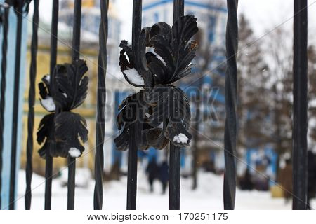 Iron Fence On The Background Of The Church.