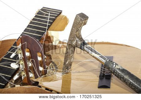 An acoustic guitar in pieces. Smashed with a masonry hammer by its frustrated guitarist owner. No more music scales.