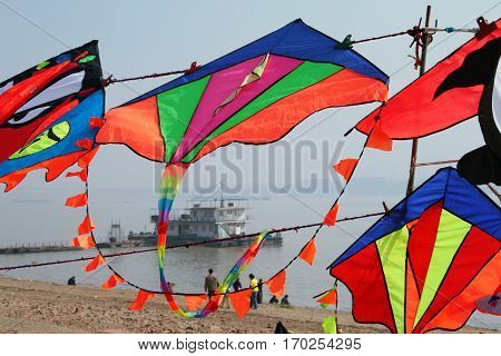 Multicolor kites on a background of Yangtze river Wuhan China