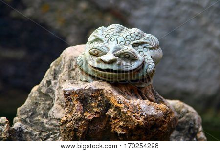 Jade Toad in the pond of chinese Taoist temple