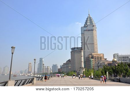 SHANGHAI - AUG. 13, 2012: Historical buildings in the Bund by the Huangpu River, City of Shanghai, China.