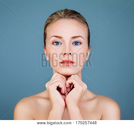 Spa Model Woman with Healthy Skin on Blue Background. Aesthetic Medicine and Skincare Concept