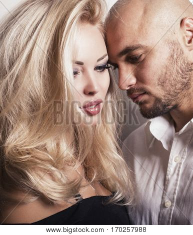 Impassioned Couple. Gorgeous Woman With Blond Hair Posing With Handsome Man