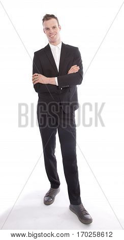 Young businessman standing isolated on white background