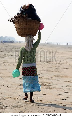 Garbage collector on the beach of Goa