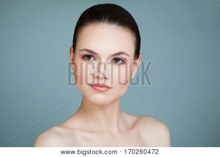 Perfect Face. Healthy Model Woman on Blue Background. Aesthetic Medicine and Treatment Concept