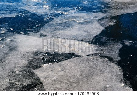 Blocks of ice on the frozen pond. Spring comming background