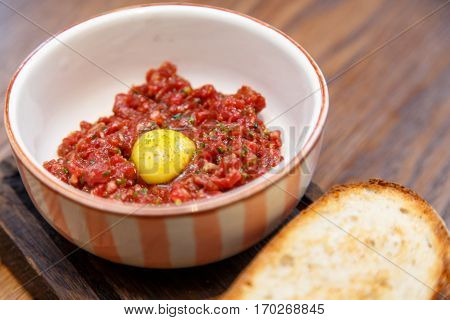 Beef Tartare With Quail Egg And Rustic Bread.