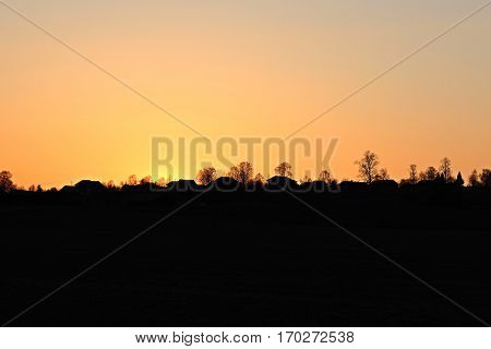 Bright Dramatic Sky And Dark Ground. Countryside Landscape Under Scenic Summer Dramatic Sky In Sunset Dawn Sunrise. Skyline.