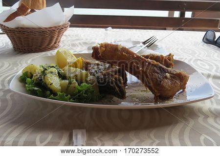 Fried fish (carp) in the restaurant at Skadar lake, Montenegro.