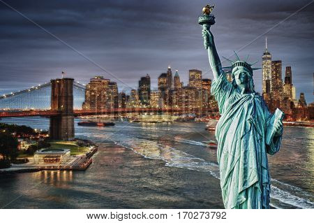 Collage - Manhattah skyline with Brooklyn Bridge at night and Statue of Liberty.