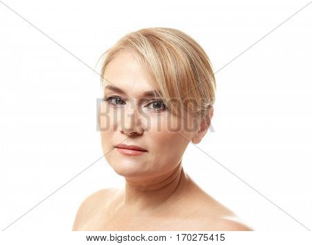 Portrait of mature woman on white background