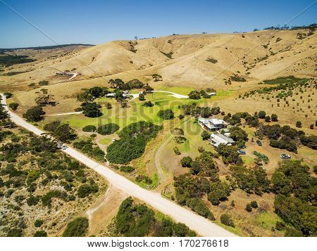 Kangaroo Island Rural Area Aerial View - Gravel Road, Yellow Hills, Coutryside Houses On Bright Sunn