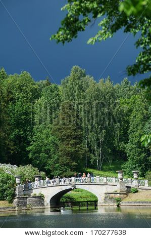 Landscape with a bridge and dark sky before thunderstorm