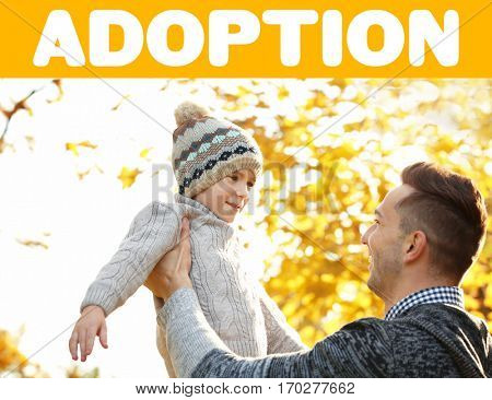 Adoption concept. Father and son playing outdoor