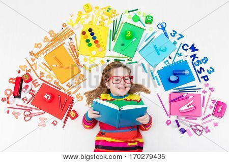 Child With School And Drawing Supplies. Student With Book.
