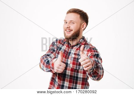 Close up Bearded man in shirt showing thumbs up at camera. Isolated white background