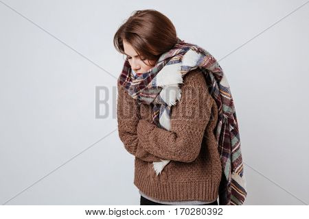 Pretty Freeze woman in sweater and scarf. Isolated gray background