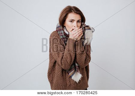 Beauty Freeze woman in sweater and scarf. Isolated gray background