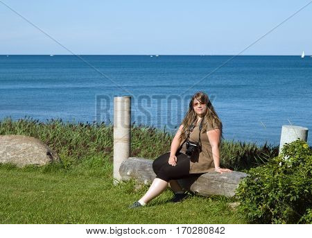 Young lady resting on coast of lake Huron