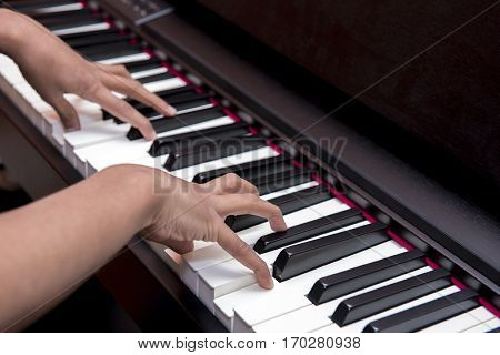 gentle hands playing the piano keys in a concert