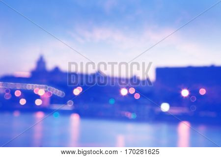Abstract blurred cityscape background with bokeh effect.