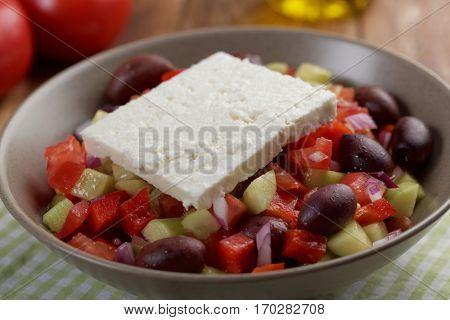 Greek salad on a rustic table