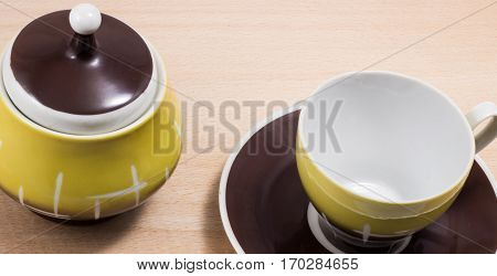 coffee set dishes on a wooden background sugar jar saucer and cup all for drinking drink