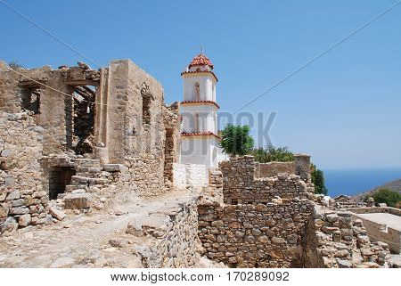 The church of Agia Zoni stands among the ruins of the abandoned village of Mikro Chorio on the Greek island of Tilos.