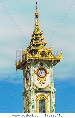 clock tower of the Maha Myat Muni Pagoda temple Mandalay city Myanmar