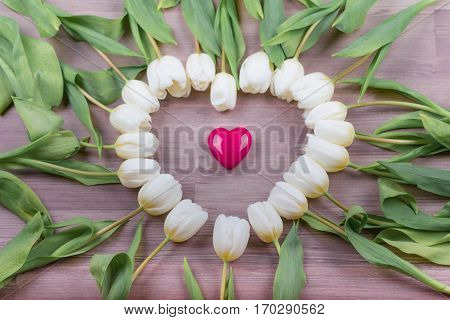 Love pink heart of tulips lovely surprise present for girlfriend. Beautiful heart shape on wood in decoration one at one tulip. Wonderful gift for e.g. valentine's day mother's day wedding birthday or anniversary.