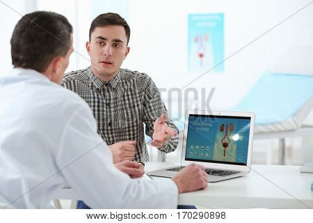 Medical concept. Doctor showing results of urology diagnostic on laptop screen