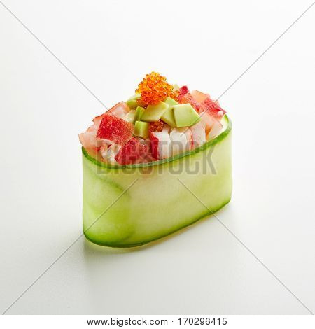 Japanese Sushi - Crab Meat and Avocado Gunkan Sushi with Tobiko on White Background. Cucumber Slice outside