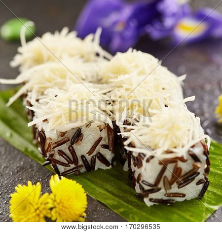 Cheese Maki Sushi - Sushi Roll topped with Cheese. Rice outside. Japanese Sushi Food and Natural Flower Concept