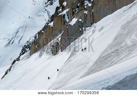 Chamonix France - December 30 2016: Climbers ascending final stretch on ridge leading up to Aiguille du Midi in early winter sunny conditions