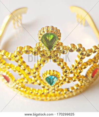 Gold princess tiara on light background