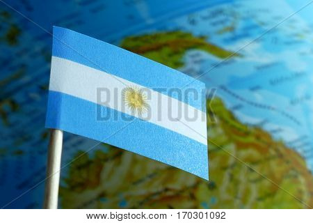Argentine Flag With A Globe Map As A Background Macro