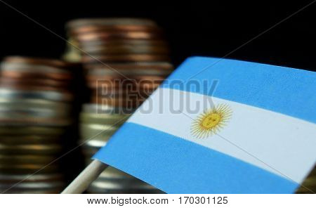 Argentine Flag Waving With Stack Of Money Coins Macro