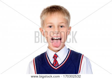 Funny nine year old boy showing his tongue. Isolated over white background. Copy space.