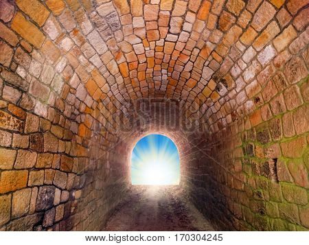 Light at end of the tunnel. Way to freedom or to heaven. Opened door from prison or grave. Hope metaphor.