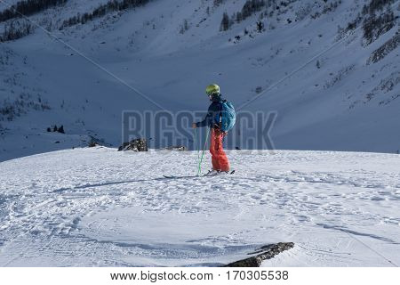 Courmayeur Italy - January 16 2017: Single skier assessing route choice ahead before sking down into mountain valley
