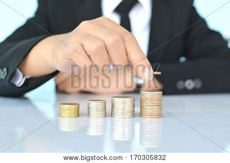 Businesswomen holding coin on blue background selective and soft focus