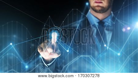 business, people, future technology and cyberspace concept - close up of businessman touching charts projection on virtual screen over dark background