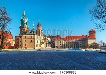 Yard square of Wawel castle in Krakow old town Poland sunny winter morning panorama landscape.