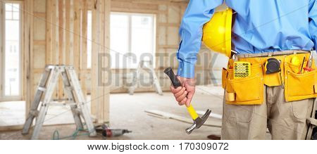 Construction worker with helmet and hammer.