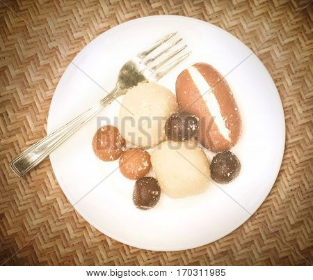 Popular Bangladeshi Sweetmeats in a plate with fork