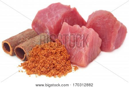 Raw beef with spices over white background
