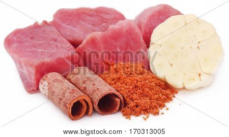 Raw beef with garlic and cinnamon with powdered spices