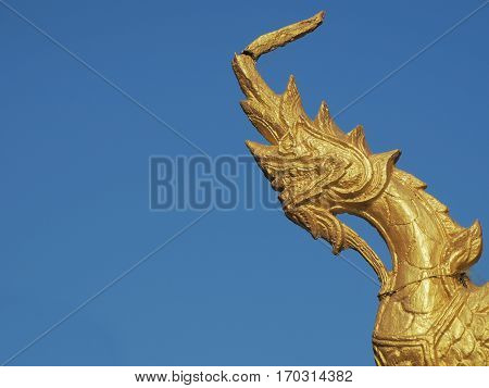 Golden Naga Or Serpent King Statue In Buddhist Temple.