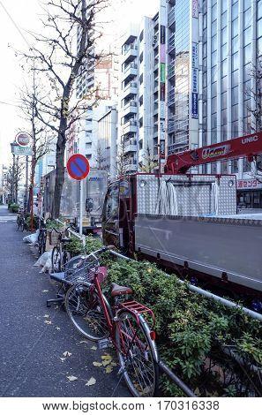 Shinjuku, Tokyo - January 7, 2014: Street view of Shinjuku. Shinjuku is a special ward located in Tokyo Metropolis, Population density of 17,140 people per km². January 7, 2014 in Tokyo, Japan.